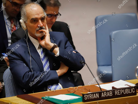 United Nations Ambassador from Syria Bashar Jaafari listens during a meeting of the U.N. Security council, at U.N. headquarters