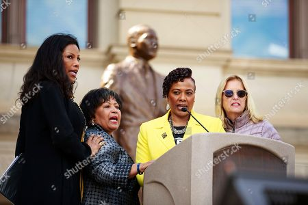 Ilyasah Shabazz, from left, Reena Denise Evers, Bernice King, and Kerry Kennedy address the crowd at the capital during the March for Humanity marking the 50th anniversary of Rev. Martin Luther King Jr.'s assassination which commenced at Ebenezer Baptist Church and concluded at the state capital, in Atlanta