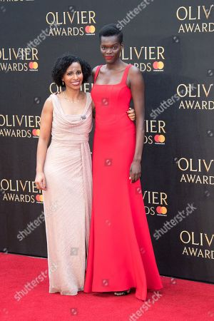 Marchu Girma (L) and Sheila Atim (R) attend The Olivier Awards with Mastercard at Royal Albert Hall on April 8, 2018 in London, England.