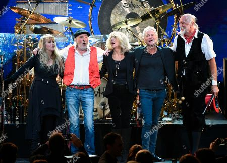 Stevie Nicks, John McVie, Christine McVie, Lindsey Buckingham, Mick Fleetwood. Fleetwood Mac band members, from left, Stevie Nicks, John McVie, Christine McVie, Lindsey Buckingham and Mick Fleetwood appear at the 2018 MusiCares Person of the Year tribute honoring Fleetwood Mac in New York. The band said in a statement Monday that Buckingham is out of the band for its upcoming tour. Buckingham left the group once before, from 1987 to 1996. He'll be jointly replaced by Neil Finn of Crowded House and Mike Campbell of Tom Petty and the Heartbreakers