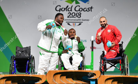 Silver medalist Paul Kehinde (L) of Nigeria, Gold Medalist Roland Ezuruike (C) of Nigeria and bronze medalist Ali Jawad (R) of England are seen during the medal ceremony for the mens lightweight competition during the Para Powerlifting on day six of the XXI Commonwealth Games on the Gold Coast, Australia, 10 April 2018.