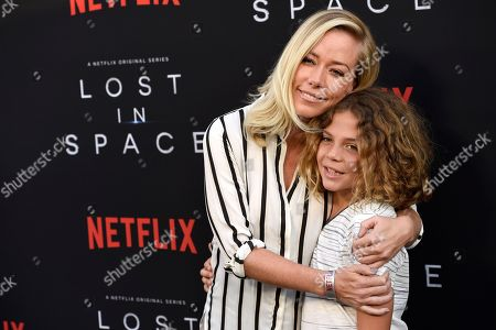 """Stock Picture of Kendra Wilkinson, Hank Baskett IV. Kendra Wilkinson, left, and her son Hank Baskett IV arrive at the Los Angeles premiere of """"Lost in Space"""" at the ArcLight Cinerama Dome on"""
