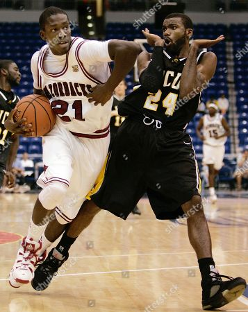 Stock Photo of Patrick Beverley, Jamal Shuler. Arkansas' Patrick Beverley, left, drives with the ball as he is guarded by VCU's Jamal Shuler during the second half of the third place game against Arkansas of the Puerto Rico Tip-Off college basketball tournament in San Juan, . Arkansas won 70-60