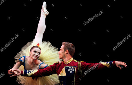 """Megan Fairchild, Andrew Veyette. Megan Fairchild, left, and Andrew Veyette, principal dancers of the New York City Ballet, perform """"Stars and Stripes"""", choreographed by George Balanchine at the Mella Theatre during the 22nd International Ballet Festival in Havana, Cuba"""