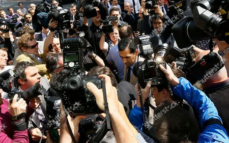Stock Photo of Race horse trainer Mahmood Al Zarooni, centre, is surrounded by media as he arrives for a disciplinary hearing at the British Horseracing Authority in London, . Samples taken from 11 of his horses were found to have contained traces of anabolic steroids