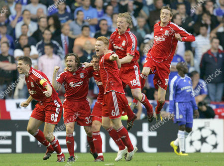 Liverpool's Daniel Agger, third left part hidden, celebrates with teammates after scoring the opening against Chelsea's during their Champions League semifinal second leg soccer match at Liverpool's Anfield stadium in Liverpool England, . Others from left are: Steven Gerrard, Boudewijn Zenden, John Arne Riise, Dirk Kuyt and Peter Crouch