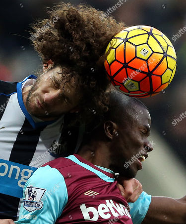 Newcastle United's captain Fabricio Coloccini, left, vies for the ball with West Ham United's Enner Valencia, during the English Premier League soccer match between Newcastle United and West Ham United at St James' Park, Newcastle, England