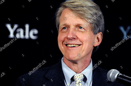 Nobel prize-winning Yale University economist Robert Shiller smiles at a news conference in New Haven, Conn. In his new book with George Akerlof, another Nobel-prize winning economist, Shiller examines the many ways credit-card companies, financial firms and other businesses lure people into buying things that might harm them