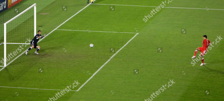Stock Photo of Austria's Ivica Vastic, right, scores the equalizing goal from the penalty spot in the last minute of the group B match between Austria and Poland in Vienna, Austria, at the Euro 2008 European Soccer Championships in Austria and Switzerland. Left is Poland's Artur Boruc