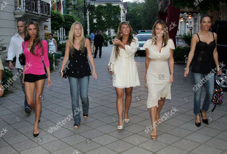Victoria Beckham (l) Leads The England Women Into Action Last Night. Victoria 32 Looked Stunning In Black Hotpants As They Headed Out To Dinner Last Night. Pictured L-r: Victoria Beckham Coleen Mcloughlin's Sister Coleen Rooney (girlfriend Of Wayne Rooney) Louise Owen (wife Of Michael Owen) And Elen Rivas (fiance Of Frank Lampard) 14.06.06. Players Wives / Girlfriends - Victoria Beckham Leaves The Brenners Park Hotel To Go Out To Dinner In Baden-baden Germany.
