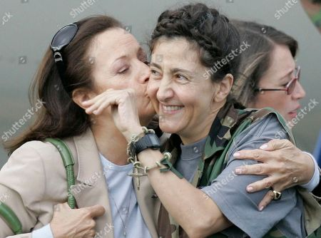 Ingrid Betancourt, Yolanda Pulecio. Former hostage Ingrid Betancourt, right, is kissed by her mother Yolanda Pulecio upon arrival to a military base in Bogota after being rescued from six years of captivity, . Betancourt is one of 15 hostages rescued by Colombia's military from the Revolutionary Armed Forces of Colombia, or FARC. Betancourt was abducted by the FARC when running for president in Feb. 2002