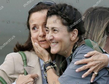 Ingrid Betancourt, Yolanda Pulecio. Former hostage Ingrid Betancourt, right, embraces her mother Yolanda Pulecio as she arrives to a military base after being rescued from six years of captivity in Bogota, . Betancourt is one of 15 hostages rescued by Colombia's military from the Revolutionary Armed Forces of Colombia, or FARC. Betancourt was abducted by the FARC when running for president in Feb. 2002