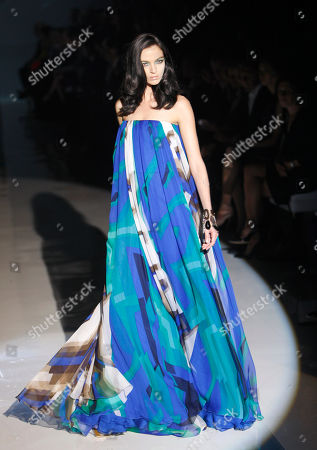 Italian supermodel Maria Carla Boscono wears a creation part of the Gucci Spring/Summer 2009 fashion collection presented in Milan, Italy, Wednesday, Sept.24, 2008