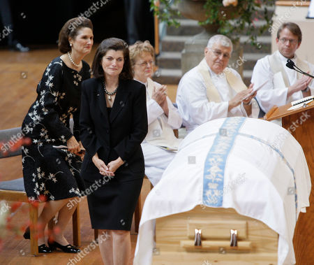 Luci Baines Johnson cries as she approaches the casket of her mother during the funeral service for former first lady Lady Bird Johnson, in Austin, Texas. Her sister Lynda Johnson Robb is on the left. Johnson the widow of former President Lyndon B. Johnson died Wednesday of natural causes