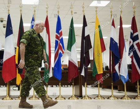 The new NATO commander of the international military operation in Libya, Lt. Gen. Charles Bouchard, arrives at a press conference at NATO headquarters, in Bagnoli, Naples, Italy, . Bouchard says he's looking into reports that air strikes on Tripoli have killed at least 40 civilians. Lt. Gen Charles Bouchard, a Canadian now heading the international operation, noted the alleged incident happened before NATO took command early Thursday