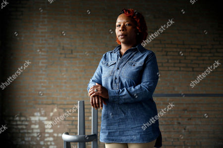 "In this April 27, 2016, photo, Lezley McSpadden poses for a portrait in St. Louis. McSpadden was sitting in her car on a smoke break from her grocery store job on Aug. 9, 2014, when a friend told her someone had been shot near Canfield Apartments in Ferguson, Mo. After that her life crumbled learning her son, Michael Brown, had been shot and killed by a police officer. McSpadden recounts what happened that fateful day two summers ago in her autobiography, ""Tell the Truth & Shame the Devil,"" set to be released, and co-written by Lyah Beth LeFlore"