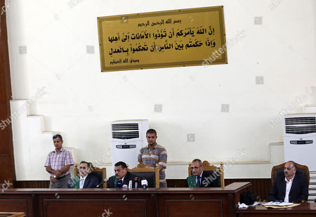 """Gamal Mubarak, Alaa Mubarak. Judges preside over a hearing involving Gamal and Alaa Mubarak, sons of deposed president Hosni Mubarak, at a courtroom in Tora Prison, Cairo, Egypt, . The court ordered the release of Gamal, Mubarak's one-time heir apparent, and his brother Alaa, a wealthy businessman, after time served on a corruption conviction. Many Egyptians view the brothers as key symbols of an autocratic and corrupt administration that struck an alliance with the mega-wealthy at the expense of the poor. Arabic verse from the Koran reads, """"Allah (God) orders you all to hand back trusts to their owners, and when you judge between people you judge with justice"""