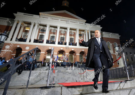 """Massachusetts Gov. Deval Patrick gestures as he completes the traditional """"Lone Walk"""" down the stairs in front of the Statehouse, in Boston. Mass. Governor-elect Charlie Baker is to succeed Patrick following Baker's inauguration Thursday, Jan. 8"""