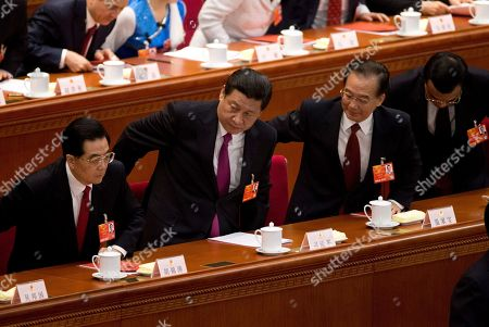 Xi Jinping, Hun Jintao, Wen Jiabao, Li Keqiang. Chinese leaders from left, former President Hu Jintao, newly installed President Xi Jinping, former Premier Wen Jiabao and newly appointed Premier Li Keqiang, stand up for the national anthem at the closing ceremony of the National People's Congress at the Great Hall of the People in Beijing . China's new leaders pledged to run a cleaner, more efficient government and slash spending on official perks Sunday as the ceremonial legislature wrapped up a pivotal session to install a new leadership in a once-a-decade transfer of power