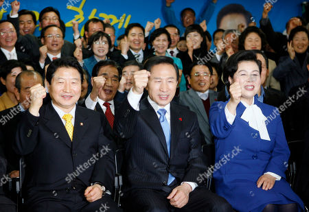 Lee Myung-bak, Kim Yun-ock. President-elect Lee Myung-bak of the opposition Grand National Party, center, with his wife Kim Yun-ock, right, and party members celebrate his victory in the presidential election at the party's headquarters in Seoul, South Korea, . At left is parliament member Ahn Sang-soo