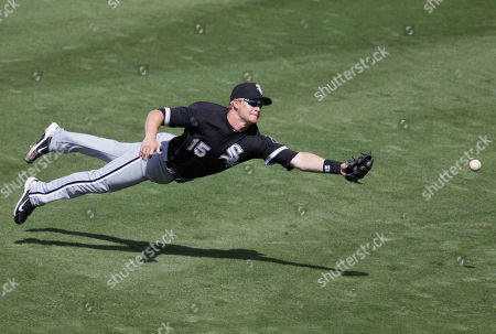 Chicago White Sox second baseman Gordon Beckham cannot catch a single by Milwaukee Brewers' Jeremy Reed during the third inning of a spring training baseball game, in Phoenix