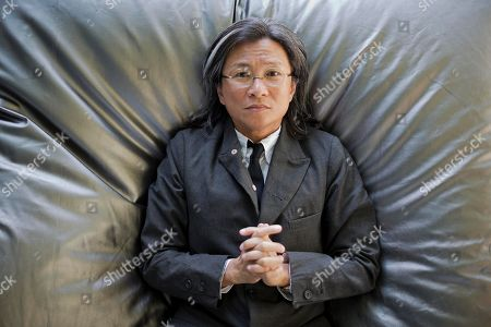 Stock Picture of Director Peter Ho-sun Chan poses for portraits during the 71st edition of the Venice Film Festival in Venice, Italy