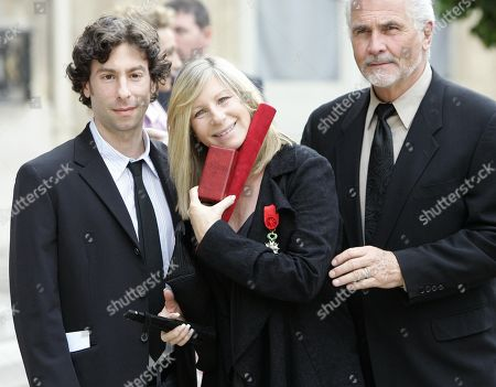 Barbra Streisand, James Brolin, Jason Gould. Barbra Streisand, center, flanked by her son Jason Gould and her husband James Brolin, shows the medal of Officer of the Legion of Honor, France's highest award, she received from French President Nicolas Sarkozy at the Elysee Palace in Paris