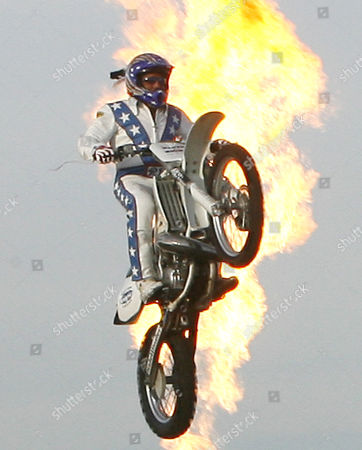 """Robbie Knievel. Daredevil Robbie """"Kaptain"""" Knievel is backlit in flames as he jumps over 24 delivery trucks, a 200 foot gap, at Kings Island amusement park, in Mason, Ohio. Thirty-three years ago, on Oct. 25, 1975, Robbie's father, Evel Knievel made history when he successfully jumped 14 buses at Kings Island"""