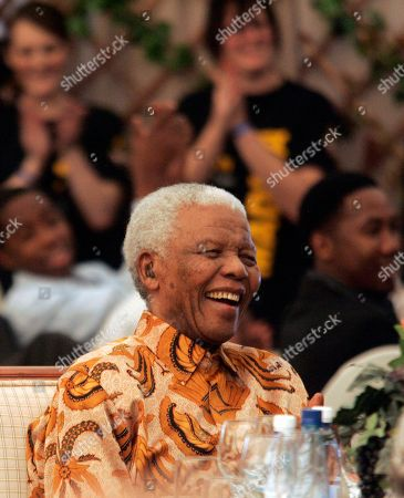 "Former South Africa's President Nelson Mandela reacts as Zambia's former President Kenneth Kaunda, unseen, makes a joke during his 90th birthday celebrations at his house in Qunu, South Africa, . Guests stood and cheered, a Xhosa choir sang ""Here is our hope!"" and a smiling Nelson Mandela welcomed hundreds of well-wishers in a festive tent outside his home Saturday for a formal celebration of the anti-apartheid icon's 90th birthday"