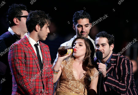 Dalma Maradona, daughter of Soccer star Diego Armando Maradona, takes a drink of tequila with the music band Panda, during the 2007 MTV Latin Video Music Awards at the Palacio de los Deportes in Mexico City on
