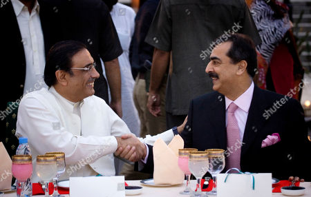 Pakistani President elect Asif Ali Zardari, left, head of the ruling Pakistan People's Party and widower of two-time Prime Minister Benazir Bhutto, is congratulated by Prime Minister Yousuf Raza Gillani during a celebration dinner at the Prime Minister residence in Islamabad, Pakistan on . The widower of slain former premier Benazir Bhutto became Pakistan's new president Saturday after winning a landslide election victory that makes him a critical partner of the West against international terrorism