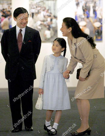 """Naruhito Masako Aiko. Japan's Crown Prince Naruhito, left, Crown Princess Masako, right, and their daughter Princess Aiko, look at exhibits during a visit to the photo exhibition entitled: """"Empress and her children"""" at Takashimaya department store in Tokyo"""