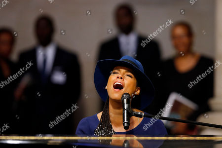 Stock Image of Singer Alicia Keys performs during a memorial service for actress Ruby Dee at The Riverside Church, in New York