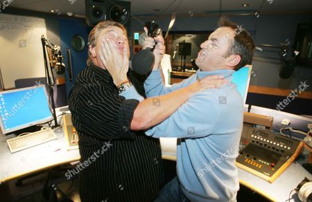 Jono Coleman And Johnny Vaughan. Jono And Johnny Get To Grips For Radio Aid They Are The Best Of Enimies On The Radio But Join Together For The Charity Broadcast.