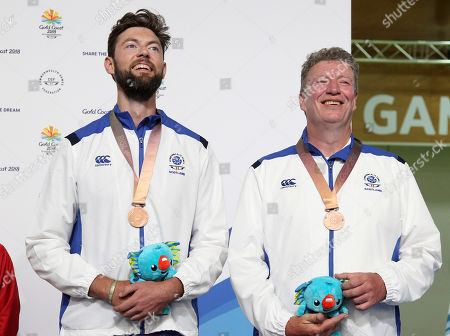 Alexander Walker, Ian Shaw. Alexander Walker, left, and Ian Shaw of Scotland pose with their bronze medals during the Queen's Prize Pairs medal ceremony at the Belmont Shooting Centre during the 2018 Commonwealth Games in Brisbane, Australia