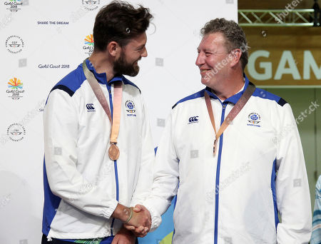 Alexander Walker, Ian Shaw. Alexander Walker, left, and Ian Shaw of Scotland shake hands after winning the bronze medal during the Queen's Prize Pairs event at the Belmont Shooting Centre during the 2018 Commonwealth Games in Brisbane, Australia