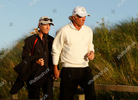 Chris Evert, Greg Norman. Greg Norman of Australia, right, and his wife Chris Evert are seen following a press conference after the third round of the British Open Golf championship, at the Royal Birkdale golf course, Southport, England