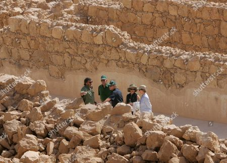 Stock Image of President George Bush, Ehud Olmert, Laura Bush, Aliza Olmert. U.S. President George W. Bush, centre, first lady Laura Bush, right, Israeli Prime Minister Ehud Olmert, 2nd left, and his wife Aliza, listen to guide Eitan Campbell, left, as they visit Masada Historic Site, in Masada, Israel. The leaders and their wives toured Masada, the ancient fortress on a plateau in the desert overlooking the Dead Sea, said to be the place where Jewish rebels killed themselves and each other 2,000-years ago rather than fall into slavery under the Romans