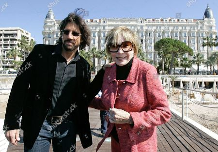 Shirley MacLaine, Christian Duguay. U.S. actress Shirley MacLaine and Canadian director Christian Duguay pose for photographers during the MIPTV (International Television Programme Market), in Cannes, southern France