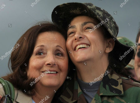 Ingrid Betancourt, Yolanda Pulecio. Former hostage Ingrid Betancourt, right, embraces her mother Yolanda Pulecio upon arrival to a military base in Bogota after being rescued from six years of captivity, . Betancourt is one of 15 hostages rescued by Colombia's military from the Revolutionary Armed Forces of Colombia, or FARC. Betancourt was abducted by the FARC when running for president in Feb. 2002