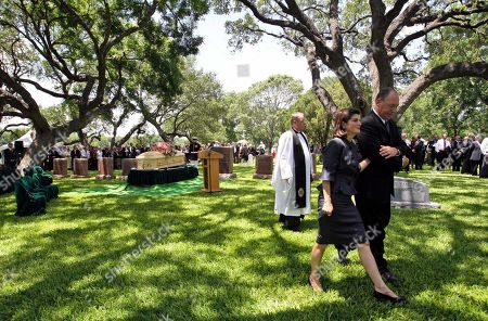 Luci Baines Johnson is escorted after a burial service for her mother, former first lady Lady Bird Johnson at the Johnson Family Cemetery in Stonewall, Texas. The widow of former President Lyndon B. Johnson died Wednesday of natural causes. She was 94
