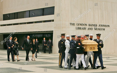 Armed services body bearers remove the casket of Lady Bird Johnson from the Lyndon Baines Johnson Library and Museum, in Austin, Texas. Private funeral services for the former first lady are scheduled for later in the day. In the background, following the casket are Mrs. Johnson's daughters, Lynda Bird Johnson Robb, with her husband, Chuck Robb, left, and Luci Baines Johnson with her husband, Ian Johnstone Turpin