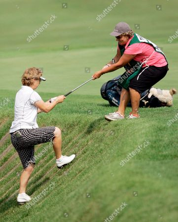 Sherri Turner, Ellie Gibson. Sherri Turner, left, gets help from her caddie Ellie Gibson after hitting out of a ravine on the 15th hole during the first round of the LPGA Championship golf tournament at Bulle Rock Golf Course in Havre de Grace, Md