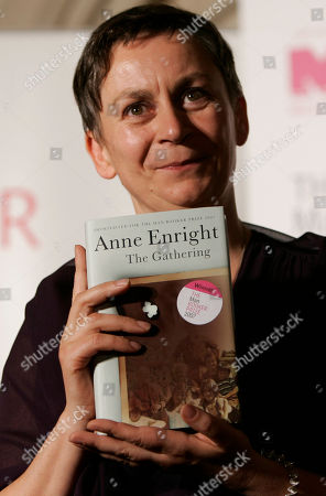 "Irish writer Anne Enright holds a copy of her book after she won the Man Booker fiction prize for ""The Gathering,"" an uncompromising portrait of a troubled family that its author called the literary equivalent of a Hollywood weepie, in London . Enright had been considered a long-shot to take Britain's most prestigious, and contentious, literary trophy. The prize, which carries a check for 50,000 pounds (US$100,000; euro75,000), was awarded during a ceremony at London's medieval Guildhall"