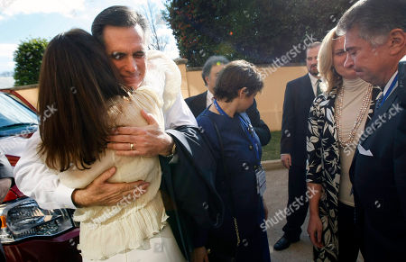 Republican presidential hopeful, former Massachusetts Governor Mitt Romney, hugs unidentified supporters as he leaves the back entrance of the Omni Shoreham Hotel after announcing his withdrawal from the 2008 presidential race in Washington, . At right is Al Cardenas, Romney's Florida campaign chairman