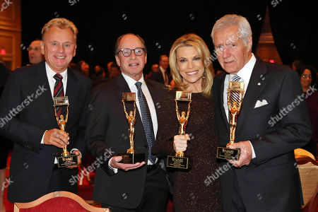Stock Photo of Alex Trebek, Pat Sajak, Vanna White, Harry Friedman. Alex Trebek, Pat Sajak, Vanna White and Harry Friedman at the NAB Broadcasting Hall of Fame Awards at the Encore Wynn Hotel, in Las Vegas