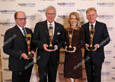 Stock Image of Alex Trebek, Pat Sajak, Vanna White, Harry Friedman. Alex Trebek, Pat Sajak, Vanna White and Harry Friedman at the NAB Broadcasting Hall of Fame Awards at the Encore Wynn Hotel, in Las Vegas