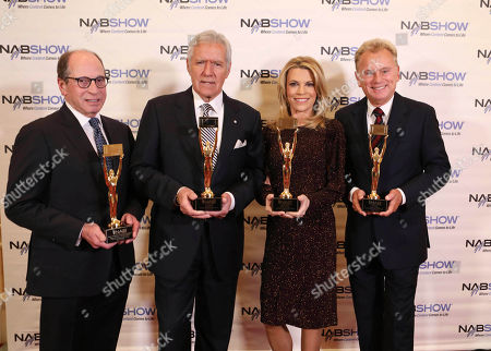 Alex Trebek, Pat Sajak, Vanna White, Harry Friedman. Alex Trebek, Pat Sajak, Vanna White and Harry Friedman at the NAB Broadcasting Hall of Fame Awards at the Encore Wynn Hotel, in Las Vegas
