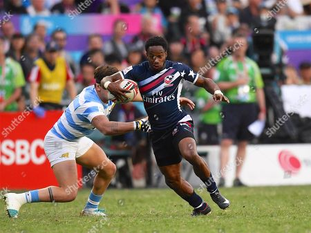 Stock Photo of USA player Carlin Isles beats a tackle to score a try in the game USA vs Argentina during the Cathay Pacific/HSBC Hong Kong Sevens festival at the Hong Kong Stadium, So Kon Po, Hong Kong. on 8/04/2018. Picture by Ian  Muir