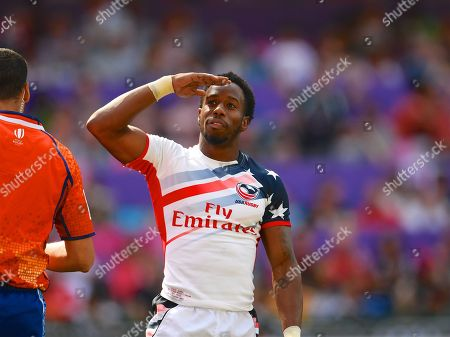 Stock Image of USA player Carlin Isles salutes a US section of the crowd after scoring a try in the game USA vs Scotland during the Cathay Pacific/HSBC Hong Kong Sevens festival at the Hong Kong Stadium, So Kon Po, Hong Kong. on 8/04/2018. Picture by Ian  Muir